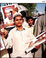 Boy with Bin Laden posters at Pakistani demonstration