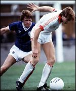 Tommy Coyne holds off John McLelland
