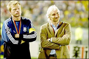 Oliver Kahn stands with Rudi Voeller as they watch Brazil collect their fifth championship