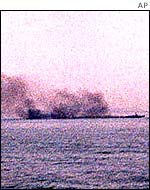 Smoke pours from a patrol ship after the battle