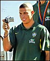 Ronaldo videos the waiting fans on his team's return to Brazil
