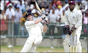 Scott Styris of New Zealand hits a six off the bowling of Ramnaresh Sarwan