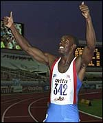 Linford Christie takes the plaudits after winning gold in 1990
