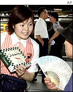 A woman sells a packed lunch at Tokyo station