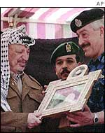 Yasser Arafat with award for Police chief Ghazi Jabali