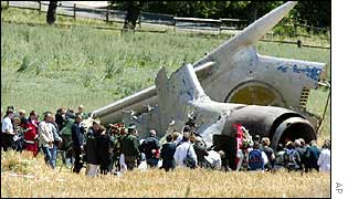 Relatives gather round the wreckage of the plane