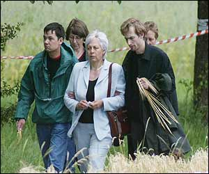 Relatives leave the crash site