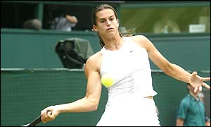 Amelie Mauresmo plays Serena Williams in the semi-finals at Wimbledon