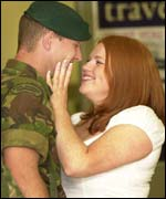 Capt Ken Cowan, from Edinburgh, is greeted by girlfriend Laura Shevlane