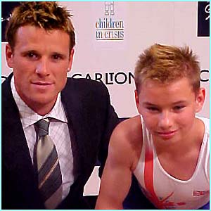 Olympic rower James Cracknell, looking rather like Beckham, flexed his muscles with Oleg Podobin the promising young gymnast