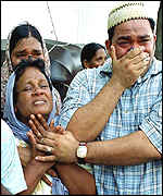 Weeping relatives after the airport attack