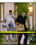 FBI agents at suspect's house