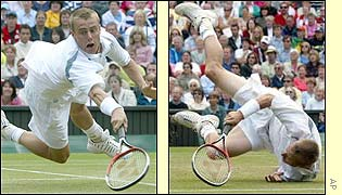 Lleyton Hewitt dives at the net during the third set