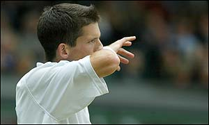 Tim Henman wipes his face as his Wimbledon dream ends against an inspired Lleyton Hewitt