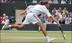 Xavier Malisse stretches for the ball at the net