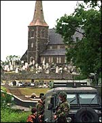 Soliders patrol near Drumcree church in Portadown