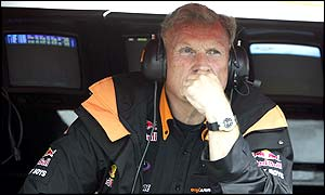 Tom Walkinshaw has financial matters on his mind as he watches his cars in qualifying at Silverstone