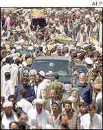 Mourners march in Kabul with Qadir's coffin which was then flown to Jalalabad
