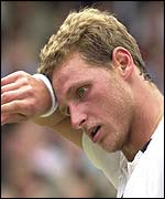 David Nalbandian mops his brow during his defeat against Lleyton Hewitt