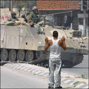 Palestinian man in front of Israeli tank