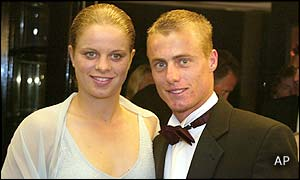 Men's champion Lleyton Hewitt and girlfriend Belgian tennis star Kim Clijsters