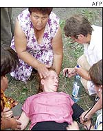 A relative of one of the dead miners is treated by medical staff