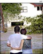 Couple watches waters flood their home