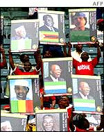 South Africans carrying posters of African leaders in Durban