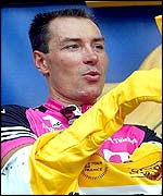 Erik Zabel puts on the yellow jersey