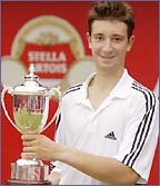 Alex Bogdanovic with the Queen's junior boy's trophy
