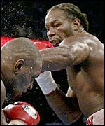 Lennox Lewis lands a punch on Mike Tyson