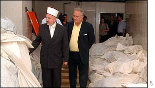 Bosnian Muslim officials inspect body bags at the Visoko identification centre
