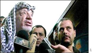 Yasser Arafat talking to reporters, 12 July.