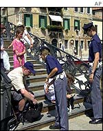 Italian police search tourists' bags on the steps of the Jewish Ghetto in Venice