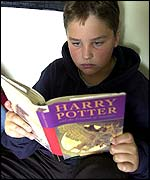 Boy reading Harry Potter book