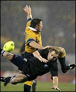 Matthew Burke and Chris Cullen collide during the Christchurch match between Australia and New Zealand