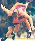 John Melling is thrown in a wrestling match