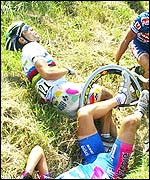 Oscar Freire lies in a ditch after the crash