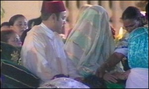 King Mohammed VI appears with his new bride
