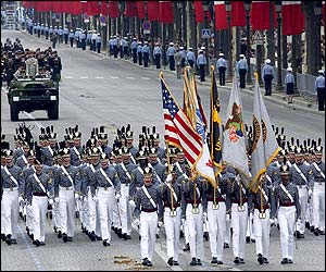 Squadron of cadets from elite US military academy Westpoint march down the Champs Elysees