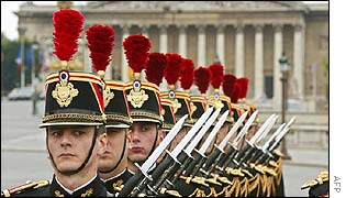 Soldiers from France's Republican Guard march down the Champs Elysees