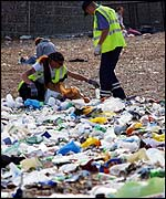 Refuse collectors and rubbish on the beach