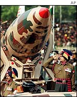 Indian soldier stands next to an Indian nuclear missile