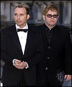 Sir Elton John (l) and partner David Furnish at a recent charity event