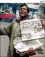 Pakistani newspaper vendor with Pearl special edition