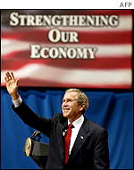 US President George W. Bush waves to the crowd at the Alys Stephens Center after speaking about the current economy at the University of Alabama in Birmingham