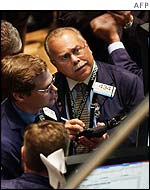 Traders watch prices at the New York stock exchange