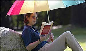 Woman in sunglasses with sun umbrella