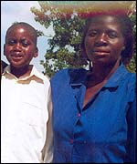 Musiiwa, a 13-year-old boy who has Aids, with his Red Cross care worker, Catherine (Pic: Red Cross)