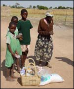 A grandmother and her grandchildren receive a Red Cross food basket (Pic: Red Cross )